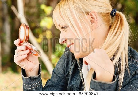 Woman Checking Hair In Mirror
