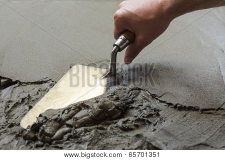 hand using trowel