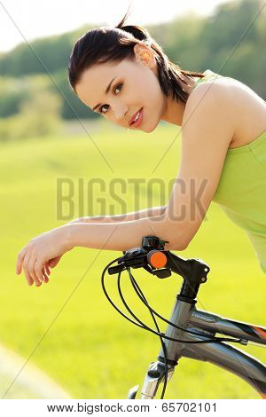 Female tourist with mountine bicycle
