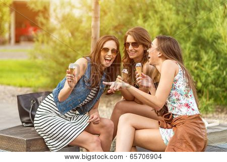3 cute women ice cream parlors while laughing