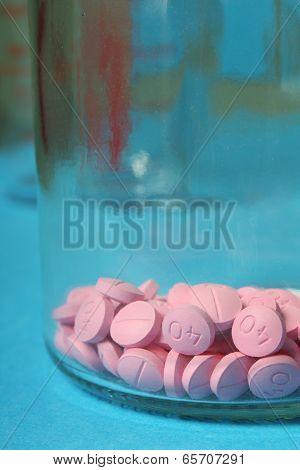 Pink Pills in a Glass Jar