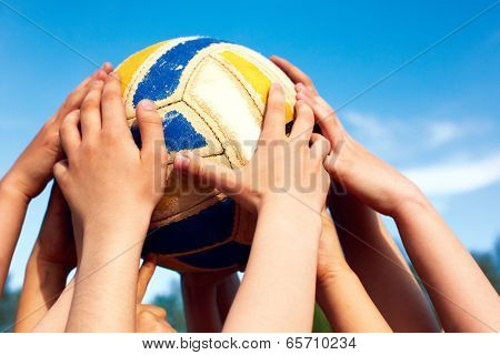 Group Of Young People Playing Volleyball