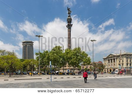 Placa With Statue Of Columbus Near The Harbor Of Barcelona In Spain