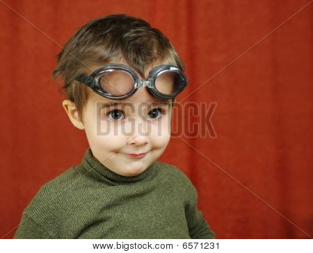 Small Boy In Swimming Glasses Plays A Pilot