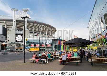 People Sitting At A Terrace Near A Dutch Soccer Stadium In Amsterdam