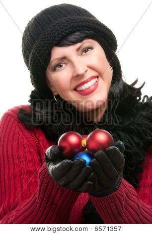 Attractive Woman Holding Christmas Ornaments