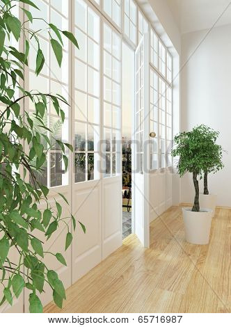 View down the length of a panoramic view window across the parquet floor of a living room to the door door onto the exterior patio of the apartment with two potted trees