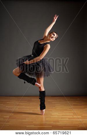 Dancing ballerina in black costume