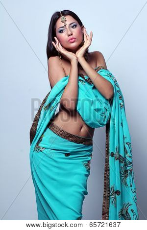 young pretty woman in indian turquoise sari