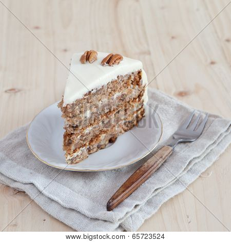 A Single Piece Of Hummingbird Cake With Pecans And Cream Cheese Frosting