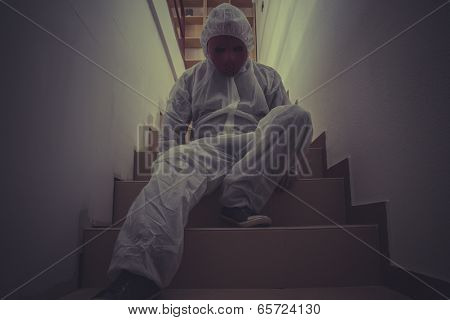 Asylum, nightmare man with red mask in empty room