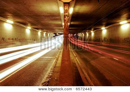 Cars Passing Through A Tunnel