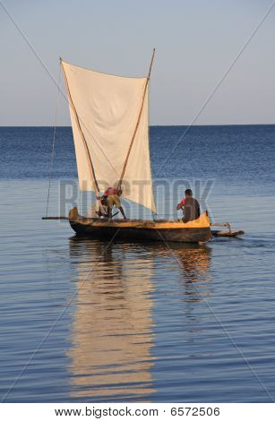 Malagasy Fishermen And Their Outrigger Canoes