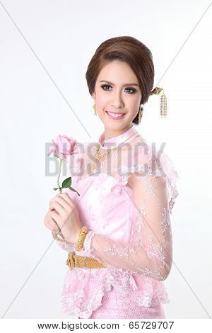 elegant fashion asian woman posing with creative chignon hair-style and wearing pink thai dress,hold