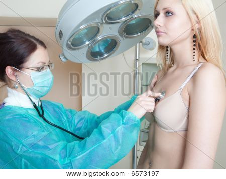Doctor Listening To Patients Heartbeat