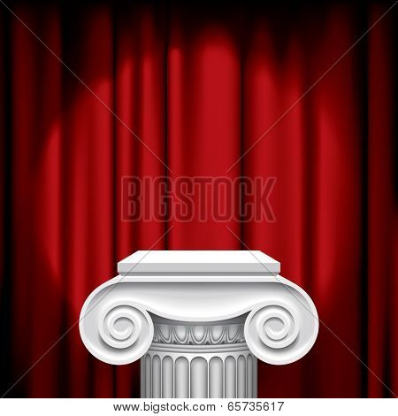 Capital of ancient column against a illuminated red fabric background (contain the Clipping Path of the capital)