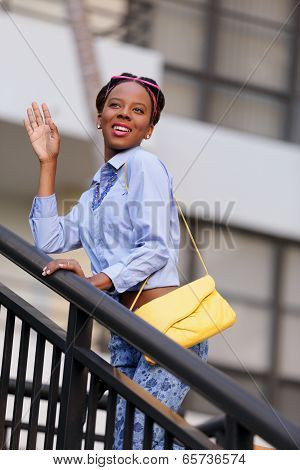 Stock image of a woman waving and smiling