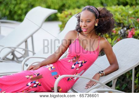 Woman posing by a pool deck