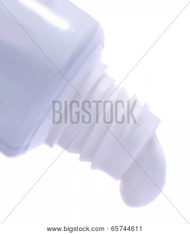 Toothpaste squeezed from tube, close-up, isolated on white