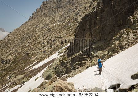 Hikers Traversing Snow Near Lac De Melo In Corsica