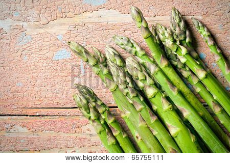 top view of green asparagus on old wooden table