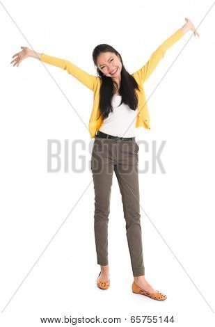 Portrait of an Asian girl open hands wide and smiling happy, full body standing isolated on white background.