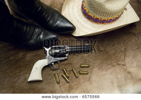 Old Revolver And Boots
