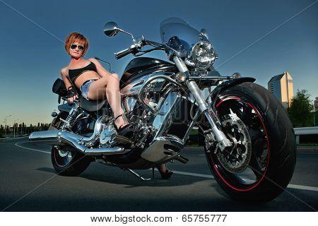 Beautiful Woman And A Motorbike