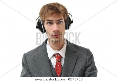 Man In Suit With Ear Phones