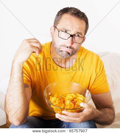 Man Eating Potato Chips