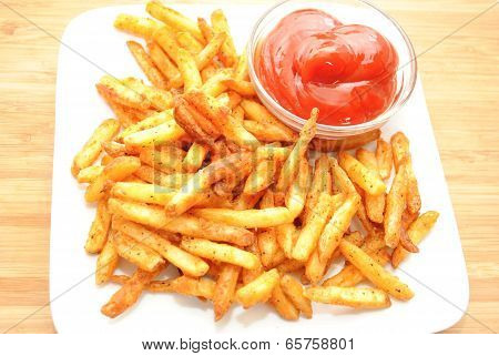 Spicy Fries Served On A White Plate With Catsup