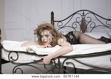 crying woman laying in bed