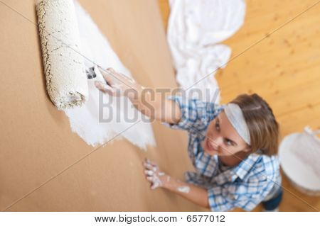 Home Improvement: Young Woman Painting Wall