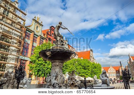 GDANSK, POLAND - 13 MAY: Fountain of the Neptune in old town of Gdansk on 13 May 2014. The bronze statue of Neptune made in 16th century is one the most recognizable symbols of Gdansk.