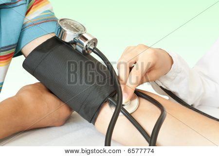 Medicine. Doctor Measures Pressure In The Patient