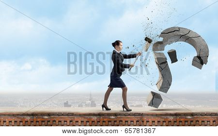 Young pretty businesswoman crashing stone question symbol