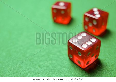 casino dices on a green felt