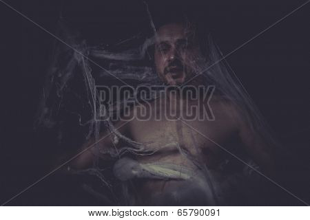 Horror, Man trapped in a spider web