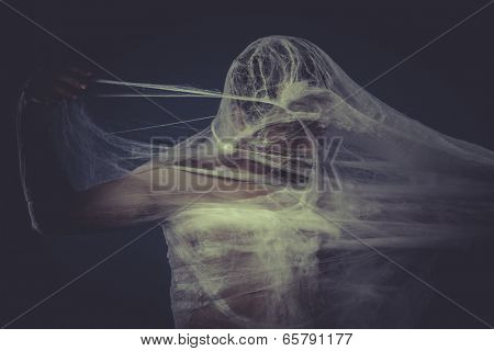 Man trapped in a spider web