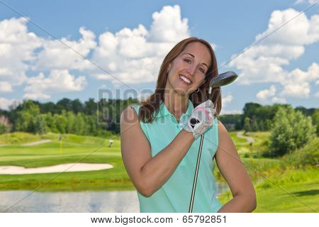Woman At The Golf Course On A Beautiful Summer Day
