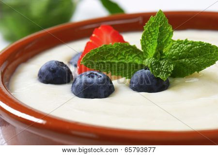 detail of bowl with hot oatmeal with immersed fresh fruit