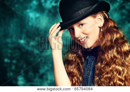 Portrait of an elegant teen girl wearing retro dress and bowler hat.