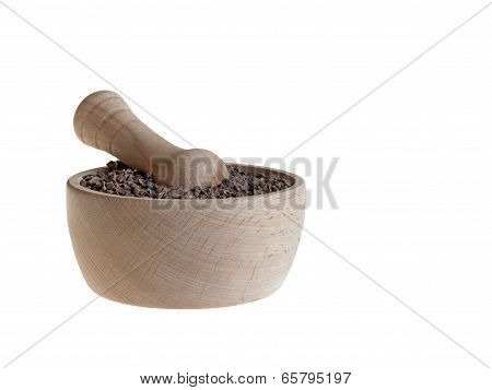 Cacao nibs in pestle isolated on white