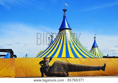 Cirque du Soleil yellow and blue tent