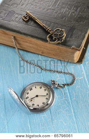 Vintage Pocket Watch, Old Book And A Brass Key