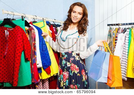 Charming young woman with shopping bags in mall