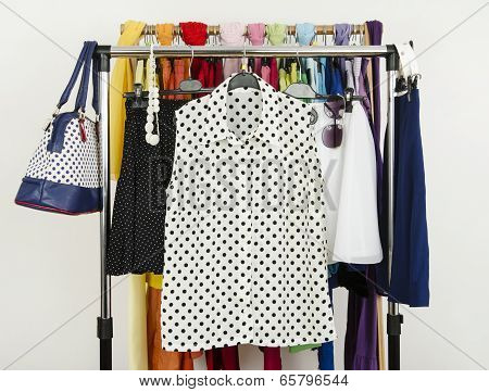 Cute polka dots summer outfits displayed on a rack.