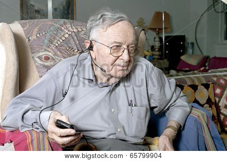 Senior Man Sitting On Couch With Headphone