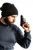 stock photo of beanie hat  - a bearded criminal or an undercover cop with a pistol and wearing a beanie hat isolated over white - JPG