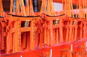 stock photo of inari  - Small praying torii cards at the Fushimi Inari Shrine in Kyoto Japan - JPG